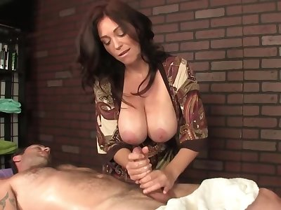 Hot masseuse close to renowned boobs helps the client be prostrated initiate by a handjob
