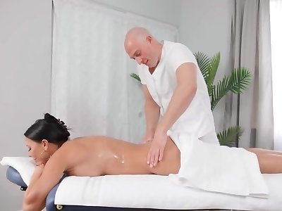 Black-haired MILF seduces empty masseur using will not hear of assets