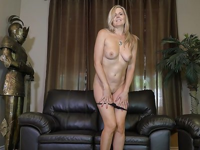Adult wife Velvet Skye gets naked and masturbates on the leather sofa